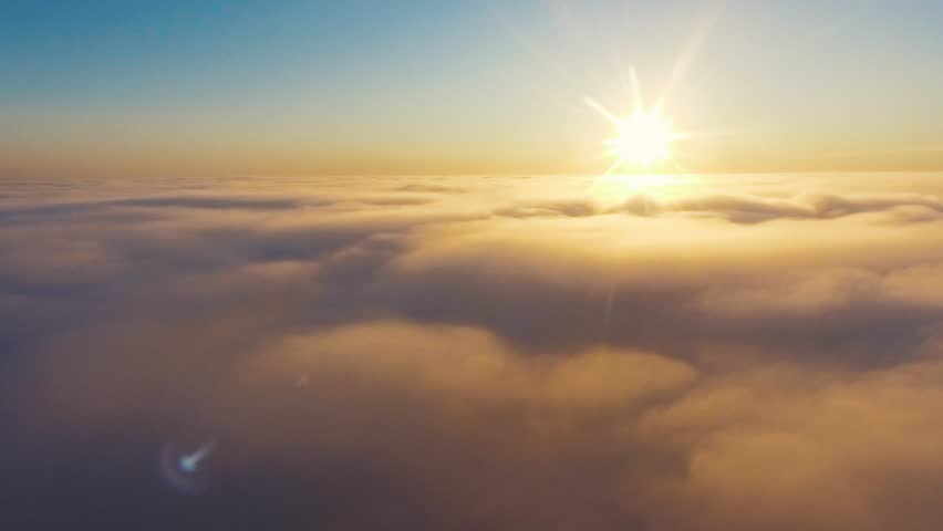 Aerial View. Flying in fog, fly in mist. Aerial camera shot. Flight above the clouds towards the sun. Misty weather, view from above. Birds point of view | Shutterstock HD Video #32050285