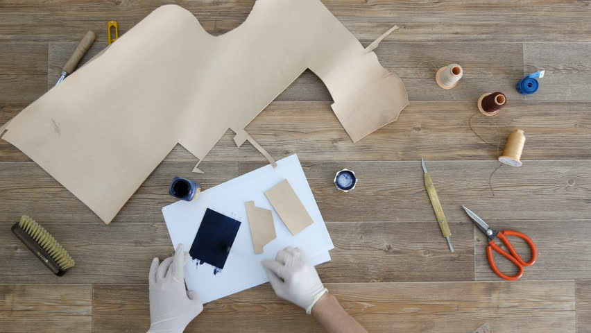 Tanner paints pieces of leather top view | Shutterstock HD Video #32067280