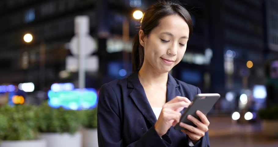 Business woman use of cell phone in Hong Kong  | Shutterstock HD Video #32074966