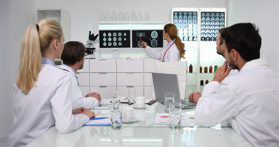 Medical Team of Doctors Talk Examine Brain Radiography Busy Activity in Hospital | Shutterstock HD Video #32075914