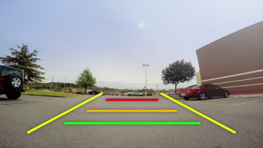 A car's backup camera in action. Simulated video feed with warning lines as objects get closer. | Shutterstock HD Video #32084851