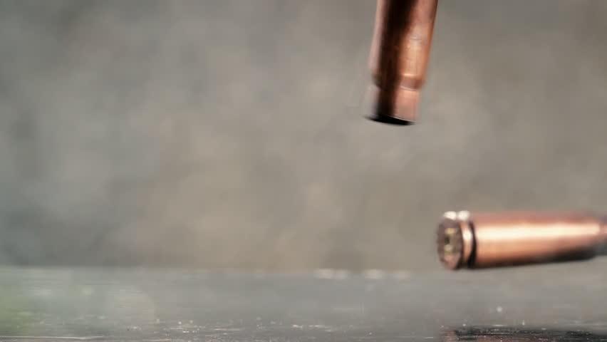 Gun bullet cartridges falling closeup