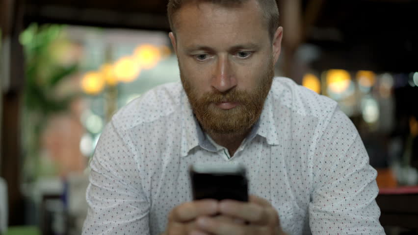 Handsome man who looks absorbed, steadycam shot  | Shutterstock HD Video #32098885