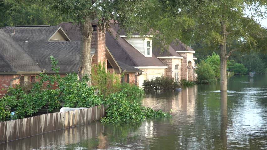 Houston, Texas - United States - August 27, 2017: Many flooded houses on road side in Texas during Harvey #32103610