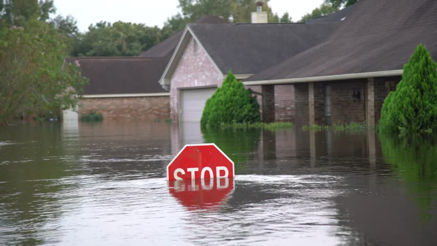 Houston, Texas - United States - August 27, 2017: Flood water reaches the level of a street sign during hurricane Harvey