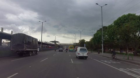 alt driving past Transmillenio station in Bogota Colombia