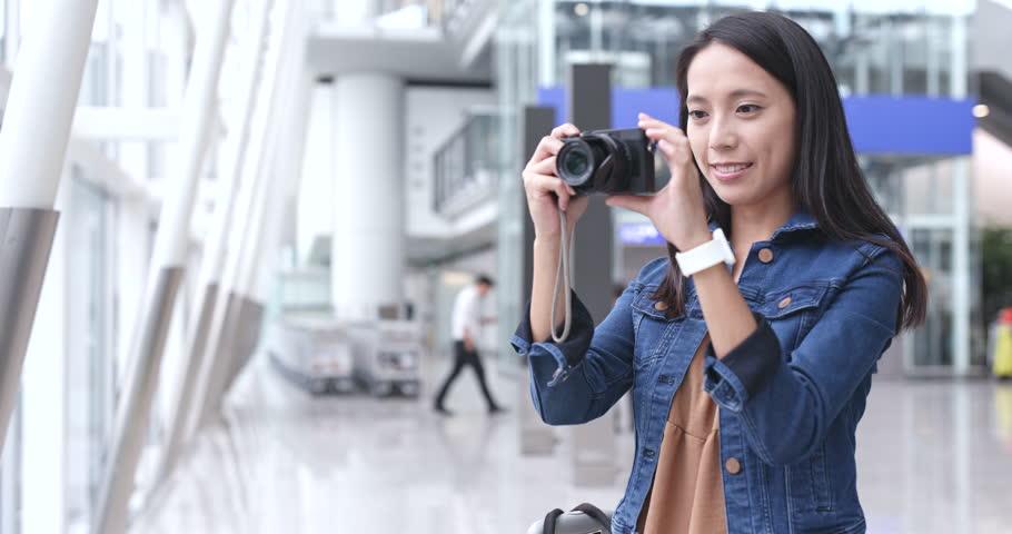 Happy woman taking photo in airport    Shutterstock HD Video #32126980