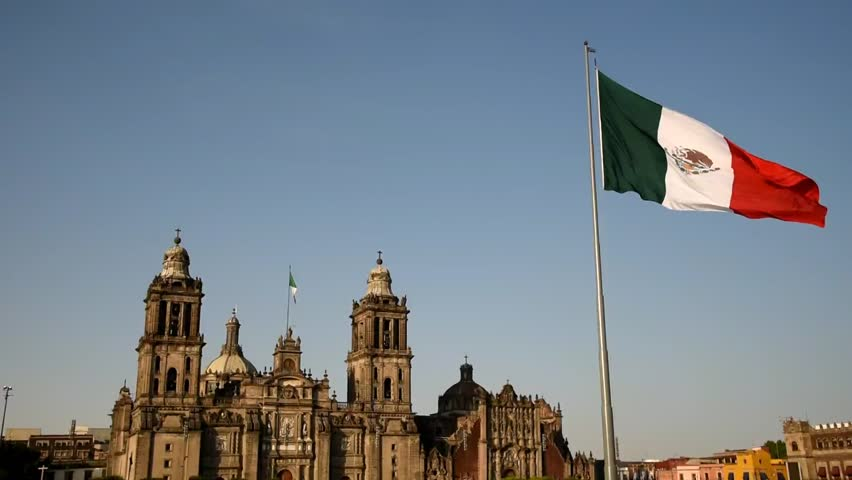 Mexico city, zocalo, square with cathedral background,Mexican flag in the foreground