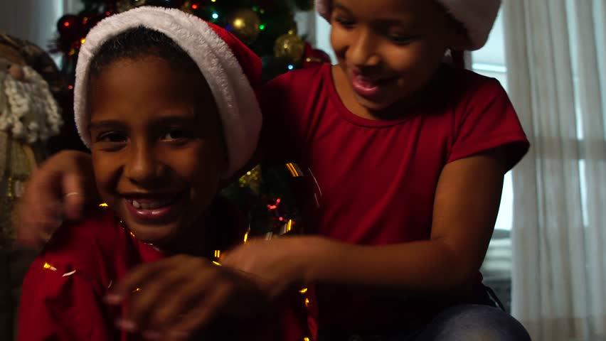 Children playing with Christmas lights | Shutterstock HD Video #32141887