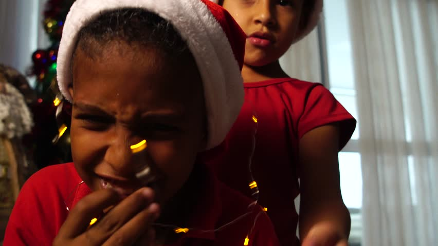 Children playing with Christmas lights | Shutterstock HD Video #32141923