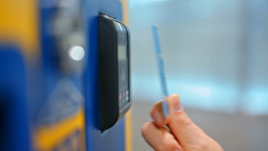 CloseUp of Paying by a Credit Card using Paypass Reader on a Ticket Vending Machine with Terminal