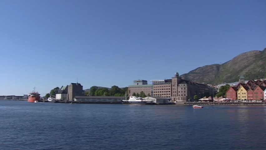 BERGEN, NORWAY: pan skyline hanseatic town of Bryggen, the old wharf  of Bergen in Norway.  Bryggen was an important Hanseatic town from the 14th to the 16th century and is a World Heritage Site.