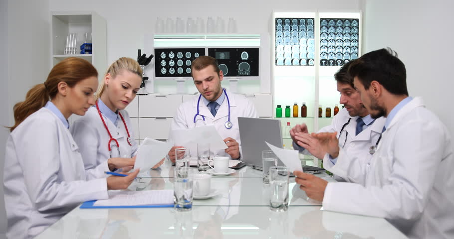 Team of Doctors Discuss Results of Pie Chart Data Teamwork Meeting Room Activity | Shutterstock HD Video #32167897