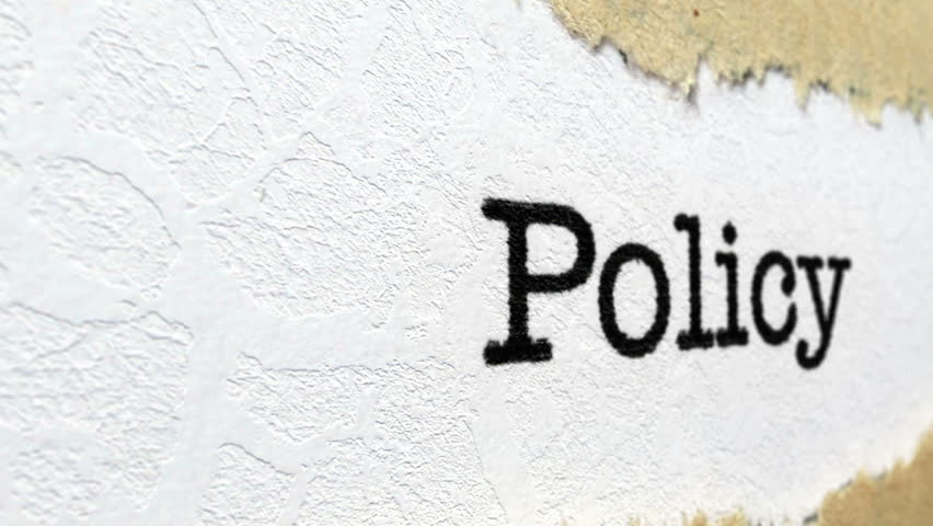 Policy text on torn paper Royalty-Free Stock Footage #32190460