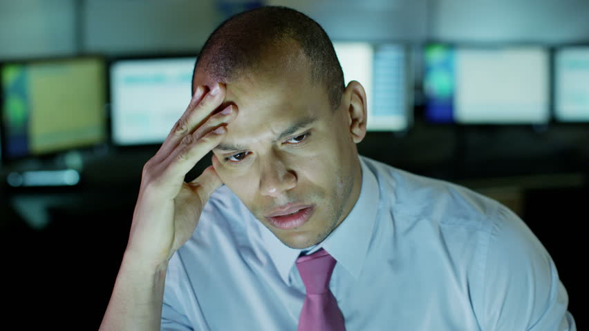 Tired and stressed businessman is working late into the night | Shutterstock HD Video #3220222