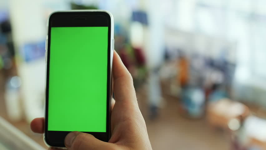 Closeup man hand using smart phone application pointing green screen touching display mockup blurred background internet searching networking business finance trendy lifestyle hitech appstore offline | Shutterstock HD Video #32205649