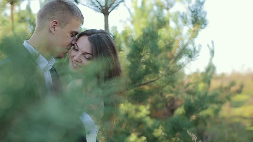 The couple in the woods bride and groom on edge of pine forest on the wedding day. Slow motion #32219875