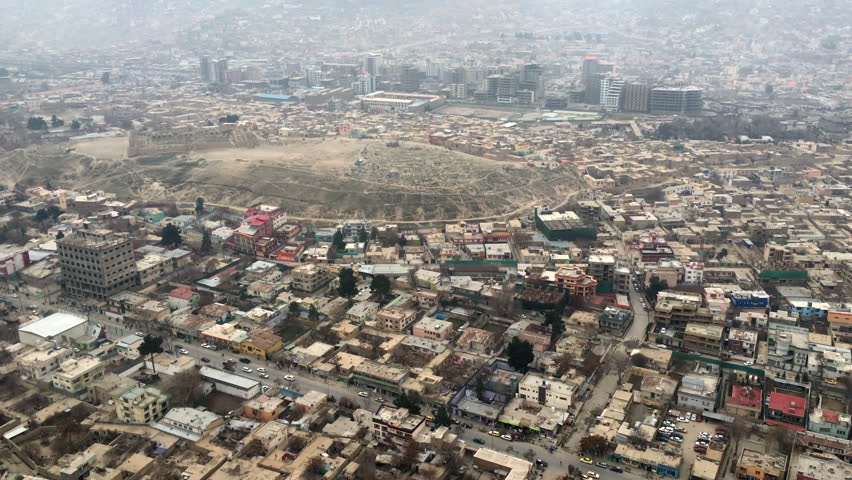 Surveillance Helicopter Ride over Kabul, Afghanistan During War Time