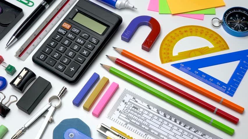 School office stationery supplies flat-lay on white table background top view. School supplies for STEM education Science, Technology, Engineer and Mathematics.