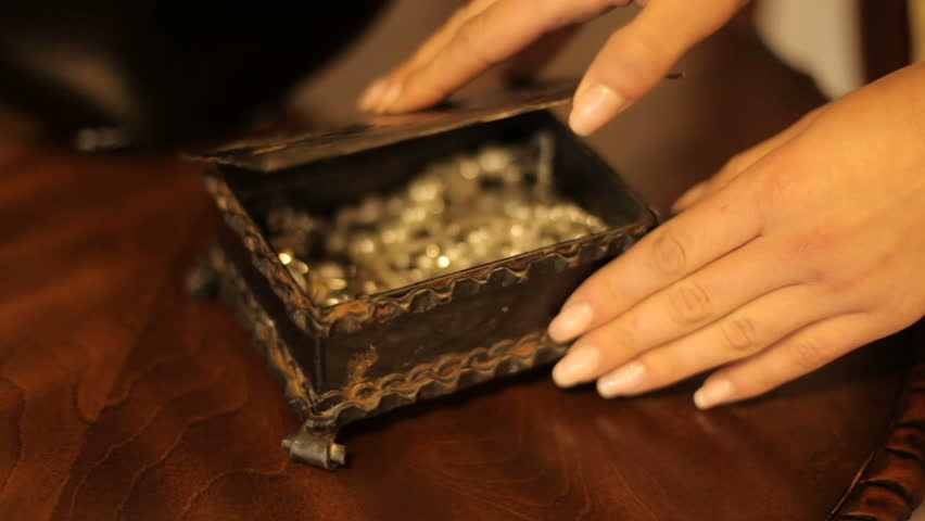 Beautiful woman opens the box. well-groomed woman's hand opens a box with jewelery. part of the body. close-up | Shutterstock HD Video #32240065