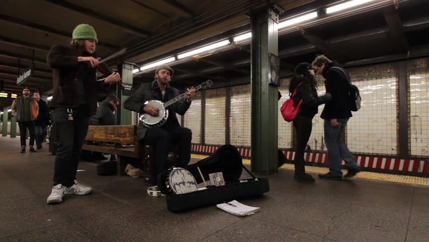 NY - DEC 23: Mountain Animation group playing in subway during busy Christmas weekend on Dec 23, 2012 in New York, NY. Bedford Ave stop in Williamsburg, Brooklyn. Popular location for young musicians and artists.