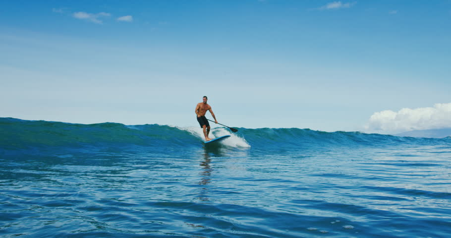 Man riding wave on stand up paddle board   Shutterstock HD Video #32245633