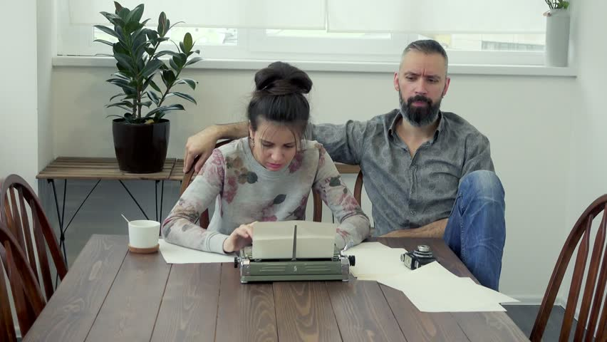 Couple of writers looking for inspiration and typiing on the typewriter   Shutterstock HD Video #32263057