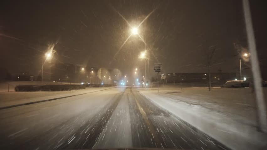 By car on a snowy road in a winter city | Shutterstock HD Video #32281309