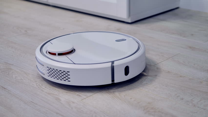 Detailed view on a self-moving robotic vacuum on the floor.       Shutterstock HD Video #32282497