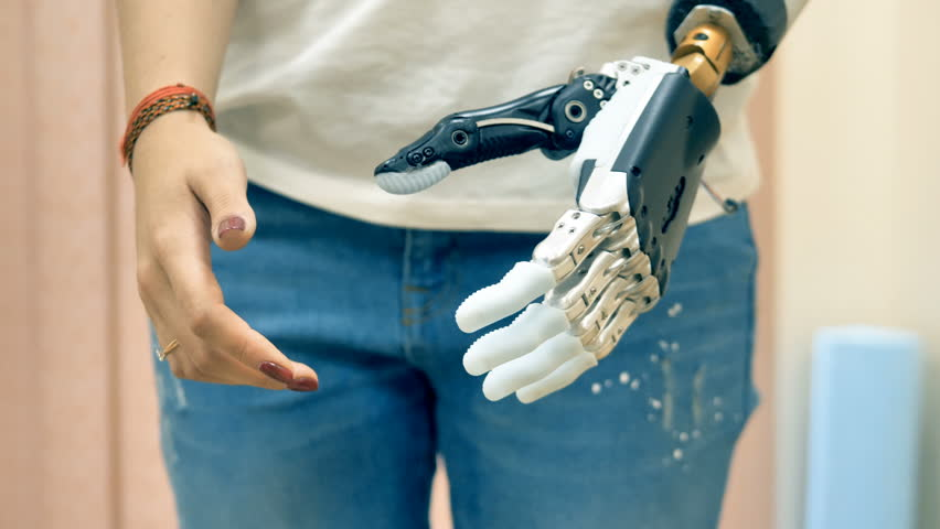 Modern medicine concept. Robotic prosthesis arm connected to a disabled woman hand. 4K. | Shutterstock HD Video #32297068