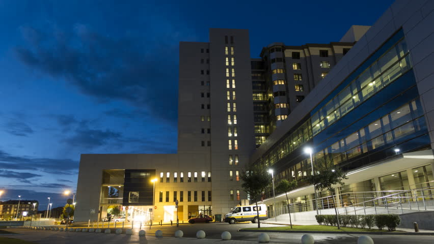 Health Care Modern Hospital Exterior Building. Night Time Lapse