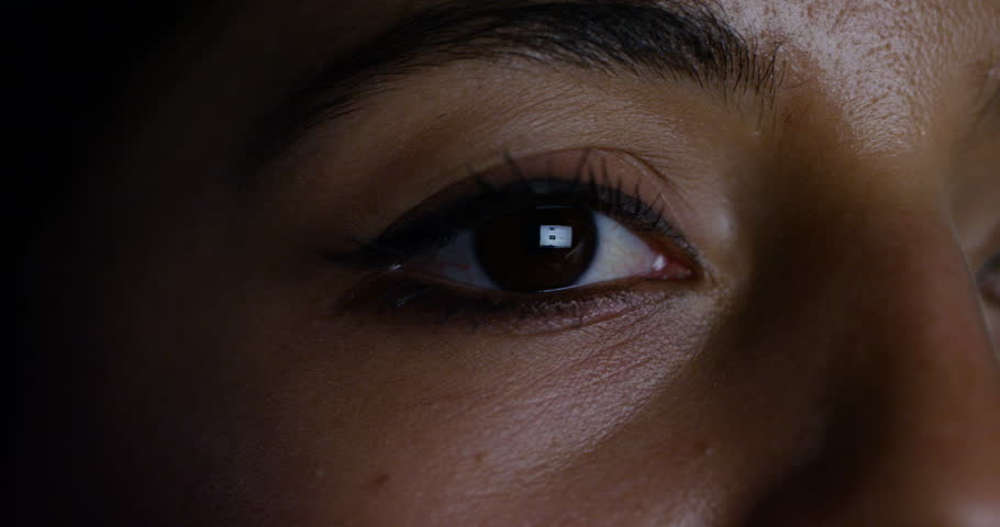 4K Close up of woman browsing the internet with screen image reflected in her eye | Shutterstock HD Video #32309293