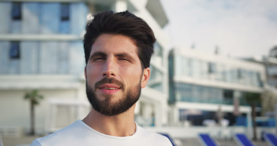 Close up portrait man with a beard standing on the beach looking at the side feels happy attractive cute lifestyle face ocean vacation summer travel sea Slow Motion Shot on RED Epic Camera. | Shutterstock HD Video #32319856