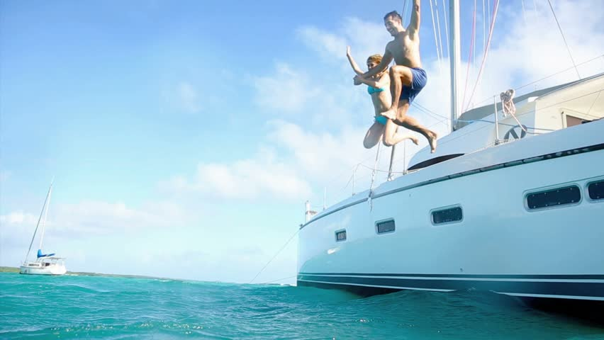 Young couple jumping in water from yacht #3232813