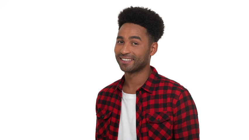half-turn portrait of brunette afro guy wearing trendy red plaid shirt being satisfied showing OK sign meaning everything's fine isolated over white background. Concept of emotions