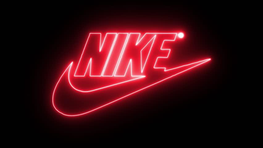Mojado Empuje hacia abajo Odio  Nike with Neon Lights. Editorial Stock Footage Video (100% Royalty-free)  32368180 | Shutterstock