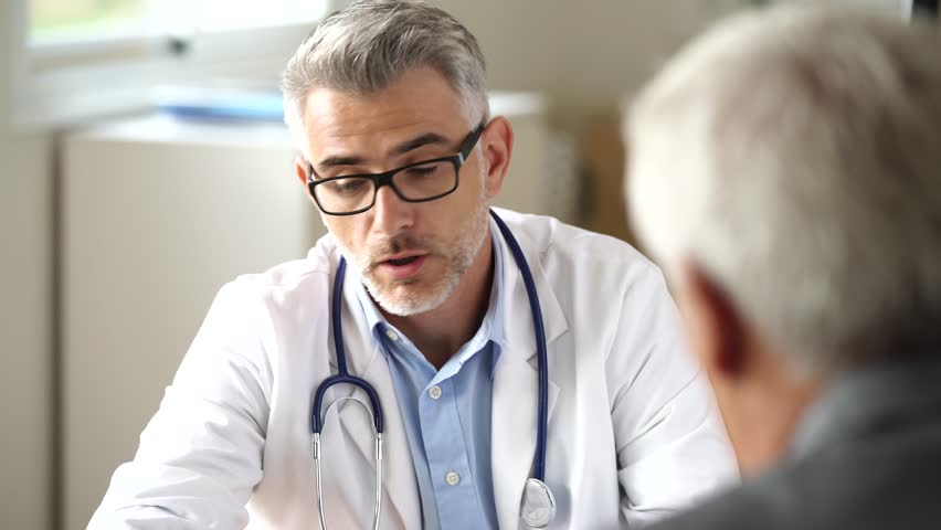Doctor talking to patient in office