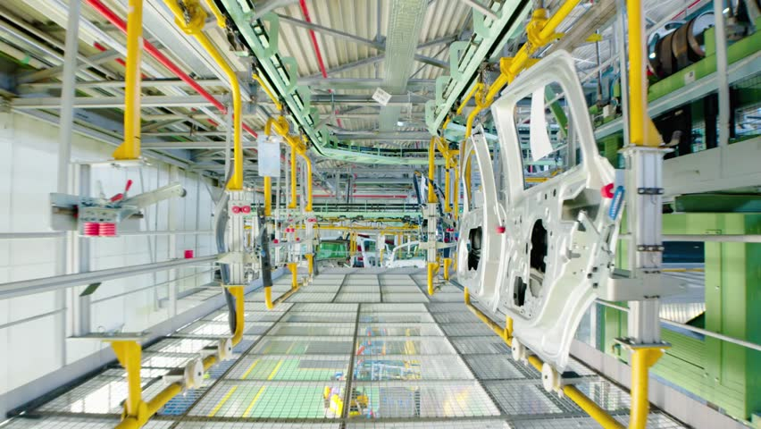 Car manufacturing industry. Assembly line of car parts. Row of car doors