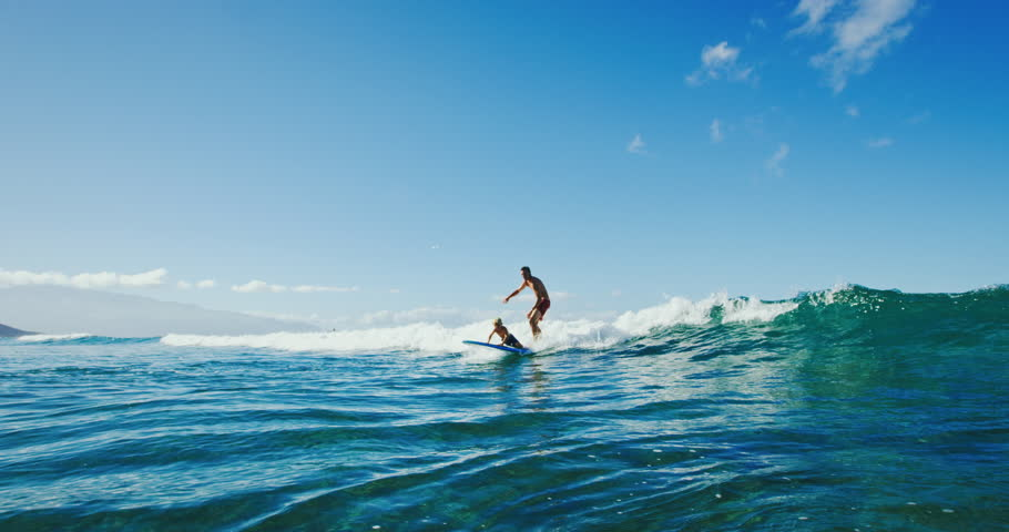 Father and surfing tandem on long board   Shutterstock HD Video #32387134