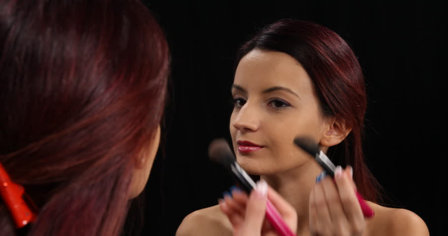 Young Sexy Woman Apply Blusher on Cheekbones with Smooth Bristles Looking Mirror