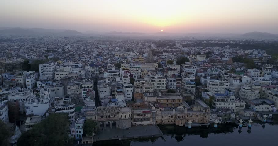 Aerial Sunset over Lake Pichola and the City Palace in Udaipur, Rajasthan, India - 4K