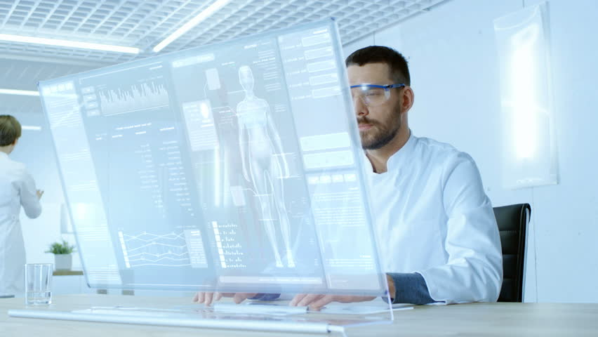 In the Futuristic Laboratory Scientist Work on Transparent Computer Display, They Try to Prolong Human Life. Screen Shows Various Human Related Infographics and Data. Shot on RED EPIC-W 8K Camera. Royalty-Free Stock Footage #32412760