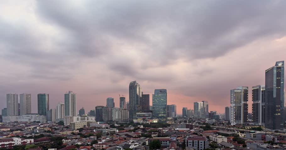 Sunset time lapse, as a day to night, with a pan to the right, over Jakarta skyline business district in Indonesia capital city. Jakarta is Indonesia capital city and the largest in Southeast Asia. | Shutterstock HD Video #32413159