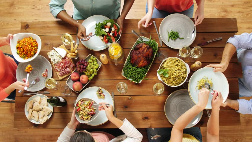 Eating and leisure concept - group of people having dinner at table with food | Shutterstock HD Video #32420251