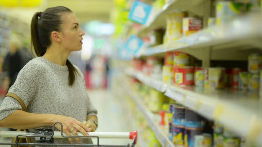 Young Wife in Casual Clothing is Choosing Food Standing Near Supermarket Shelf. | Shutterstock HD Video #32432983