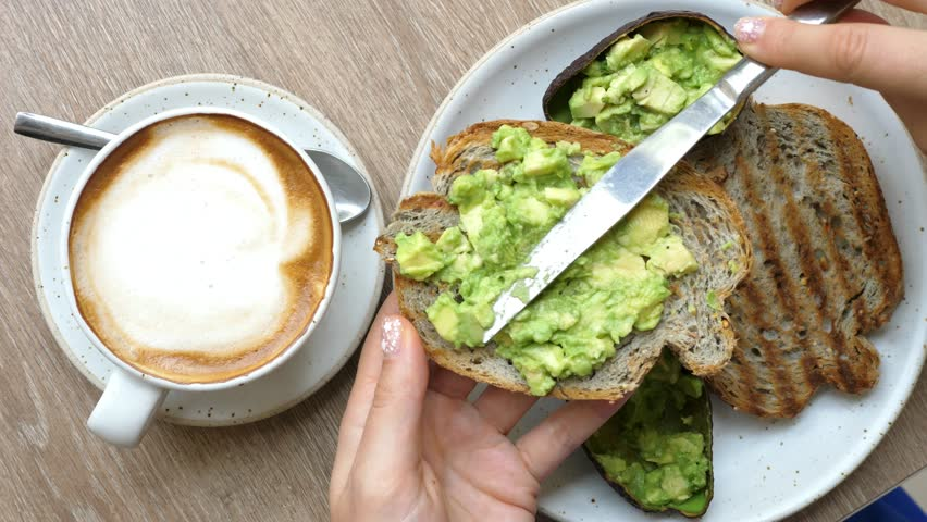 Top View Of Healthy Breakfast With Avocado Toast And Coffee In Cafe. Closeup. 4K.  #32455924