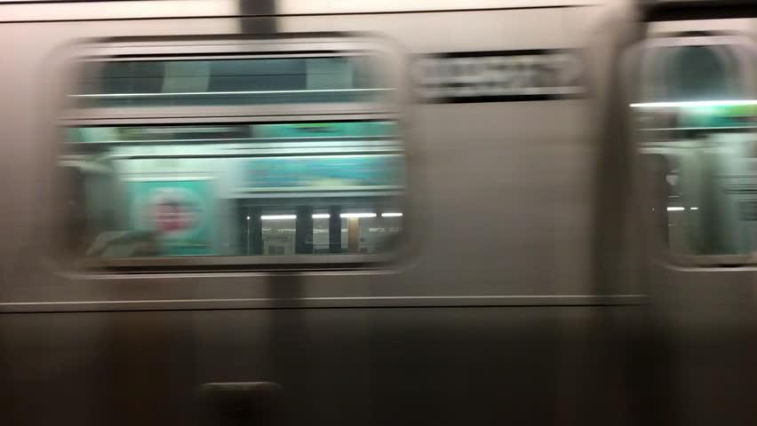 NEW YORK CITY, USA - September 20, 2017- Subway wagon train leaving station. Subway train moving forward
