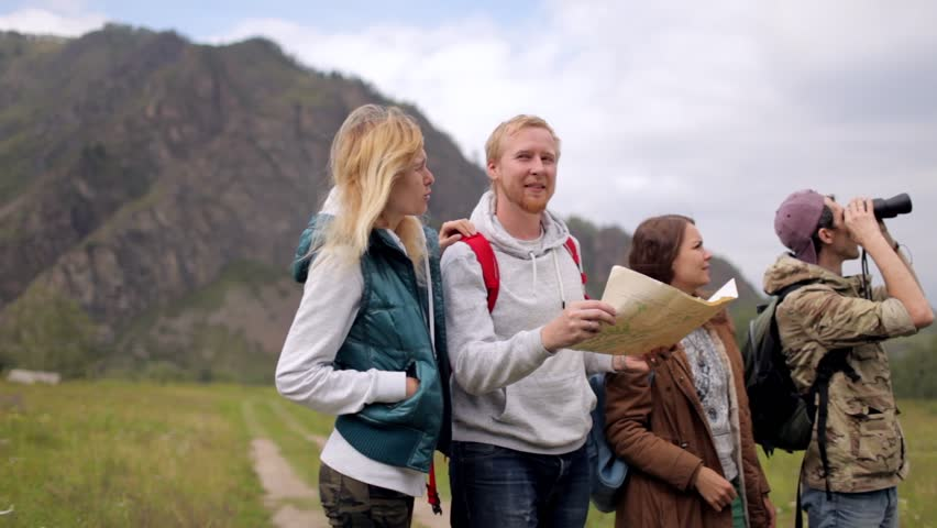 Friends travelers with backpacks do selfie on the phone in the mountains | Shutterstock HD Video #32463094