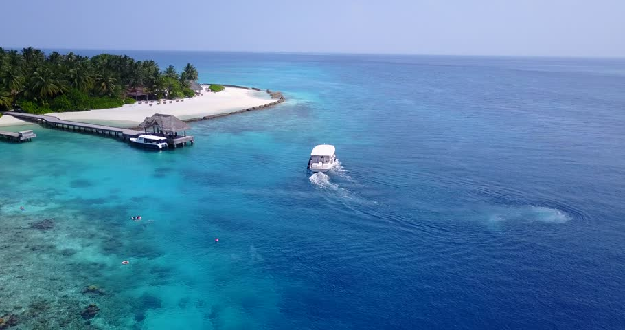 v13277 boats and sailing yachts with view from aerial flying drone in clear aqua blue sea water and blue sky #32466805