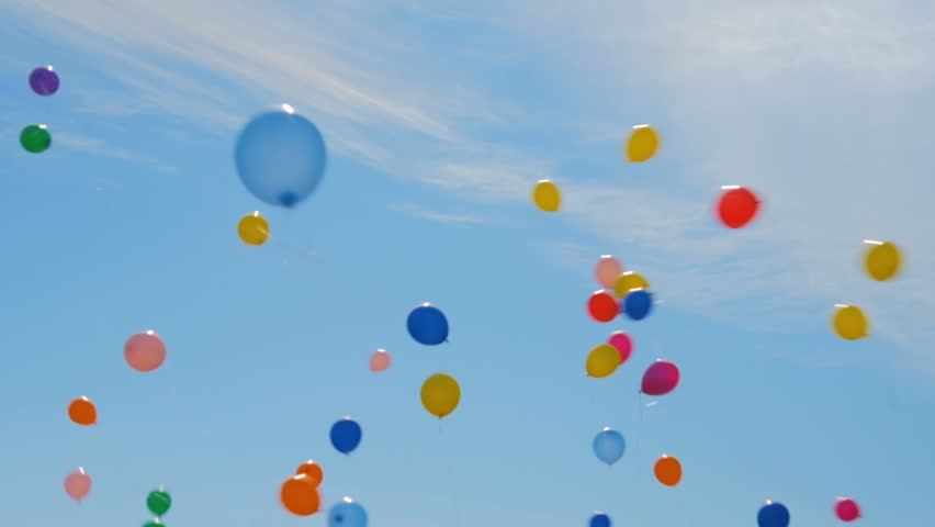 Many colorful balloons flying in the air. Celebration and birthday concept